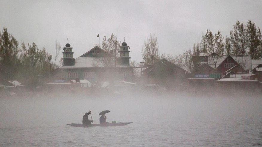 Kashmiri men ride a boat on the Dal Lake amid dense fog after fresh snowfall in Srinagar, Indian controlled Kashmir, Thursday, April 6, 2017. Heavy snowfall and rains have forced authorities in Indian controlled Kashmir to close schools and colleges even as the only all weather road link that connects the Kashmir valley to the rest of India has been cut off. (AP Photo/Dar Yasin)