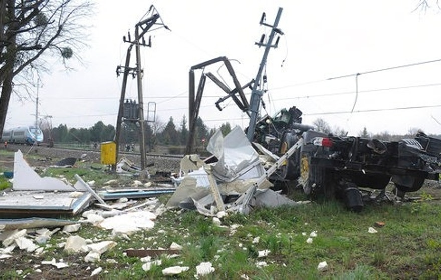 The damaged flat-bed truck after being hit by a Pendolino fast train at an unguarded railway crossing in Schodnia, southwetern Poland, Thursday, April 7, 2017.  Several people have been hospitalised some with life-threatening injuries, officials said. (AP Photo) Poland Out