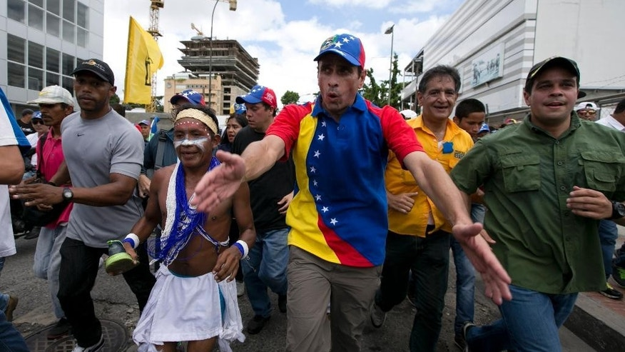 "FILE - In this Sept 1, 2016 file photo, Venezuelan opposition leader Henrique Capriles takes part in the ""taking of Caracas"" march in Caracas, Venezuela. Capriles said Friday, April 7, 2017, that a government agency has banned him from seeking office for 15 years. (AP Photo/Ariana Cubillos, File)"