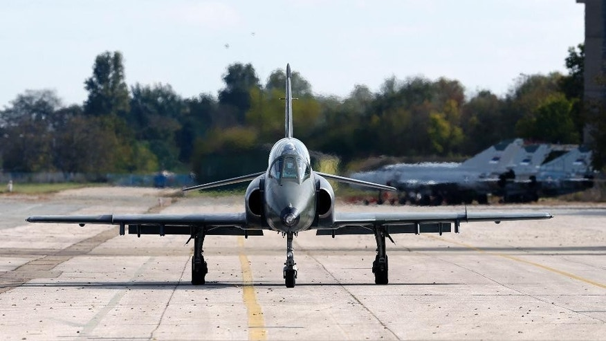 FILE - In this Oct. 13, 2016 file photo, a Serbian air force Super Galeb-4 (Super Seagull-4), multi-purpose jet rolls on the tarmac before a flight during the joint Russian-Serbian military exercises BARS (Brotherhood of Aviators of Russia and Serbia) 2016, at the military airport Batajnica, near Belgrade, Serbia. Serbia's defense ministry says an air force jet has crashed in western Serbia with two of its crew missing. A statement said the G-4 Super Galeb (Seagull) trainer aircraft has crashed in western Serbia at 10:30 local (8:30 GMT) Friday, April 7, 2017 during a routine training flight. (AP Photo/Darko Vojinovic, File)