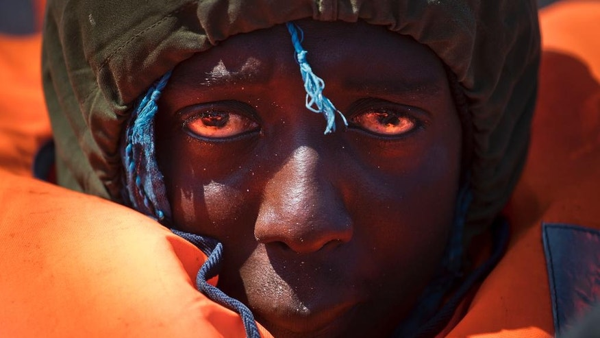 A migrant rescued from a rubber boat by members of Proactiva Open Arms NGO, in the Mediterranean sea, about 56 miles north of Sabratha, Libya, Thursday, April 6, 2017. (AP Photo/Bernat Armangue)