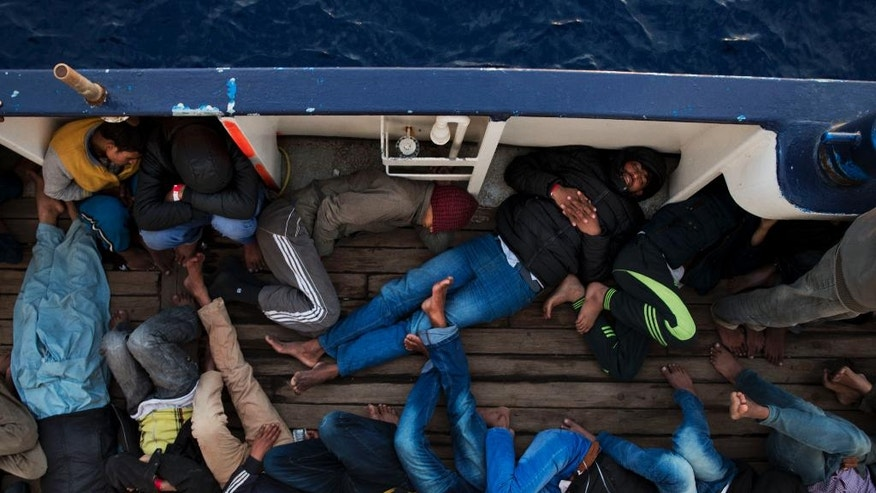 Migrants take a rest aboard the Golfo Azurro vessel after being rescued by members of Proactiva Open Arms NGO, in the Mediterranean sea, about 56 miles north of Sabratha, Libya, Thursday, April 6, 2017. Many fences are still being erected across the land route into central Europe, but these migrants will be taken to Trapani, Italy. (AP Photo/Bernat Armangue)