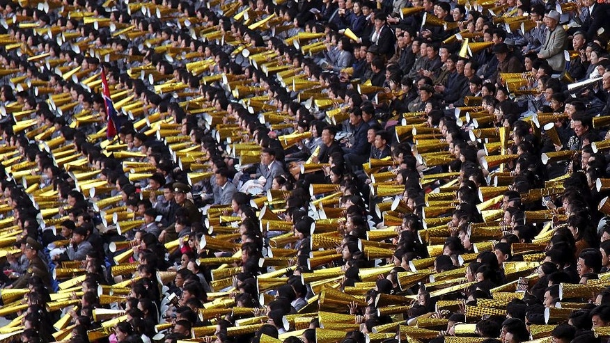 North Koreans cheer as their country's women's soccer team competes against South Korea in a qualifying soccer match for the Asian Football Confederation Cup at the Kim Il Sung Stadium on Friday, April 7, 2017, in Pyongyang, North Korea. (AP Photo/Jon Chol Jin)