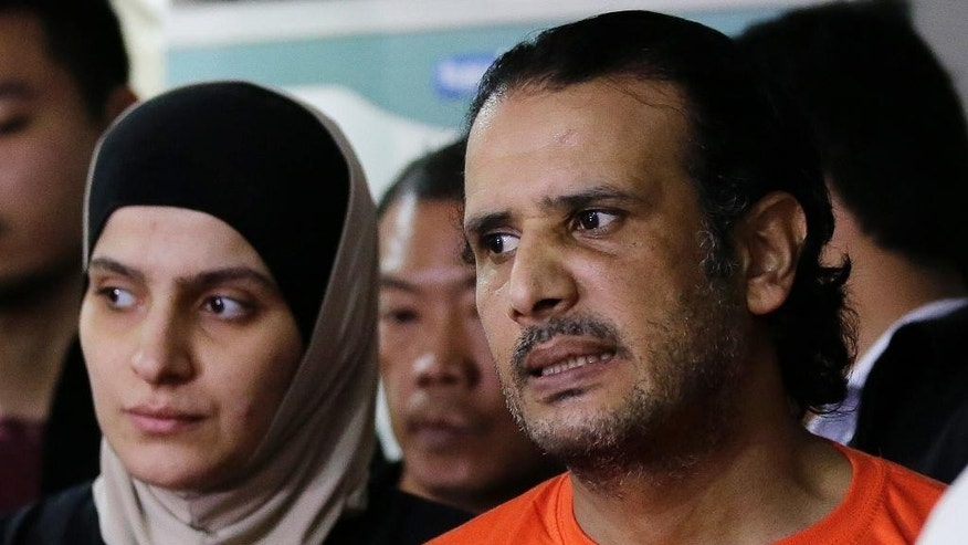 In this April 6, 2017 photo, suspected members of the Islamic State group, from left, Rahaf Zina Dhafiri and Hussein Aldhafiri are presented to reporters at the National Bureau of Investigation in Manila, Philippines. Philippine officials say U.S. and Kuwaiti security officials have helped them identify and arrest a Middle Eastern couple with suspected links to the Islamic State group and who may have the capability to launch bomb attacks. (AP Photo/Aaron Favila)