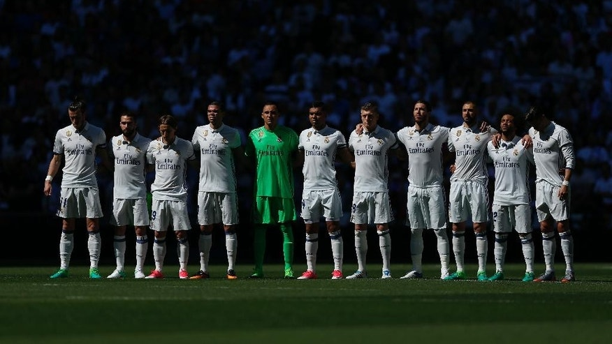 Real Madrid players observe a minute of silence for the victims of a suspected terror attack in central Stockholm before a Spain's La Liga soccer match between Real Madrid and Atletico de Madrid at the Santiago Bernabeu stadium in Madrid, Spain, Saturday, April 8, 2017. (AP Photo/Daniel Ochoa de Olza)