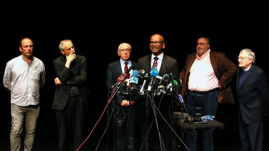 "Ram Manikkalingam, third right, a member of the commission overseeing the Basque group ETA's ceasefire, announces delivery of ETA weapons to French authorities, surrounded by others, from left, Jean Noel Etcheverry, Bishop Matteo Zuppi, Jean Rene Etxegarray, Mayor of Bayonne Michel Tubiana and Reverend Harold Good during a press conference in Bayonne, southwestern France, Saturday, April 8, 2017. In a letter Friday to the BBC, the Basque sepratist group ETA declared itself a weapons-free organization after giving up its entire arsenal to civil society groups. It confirmed the mediators, who call themselves ""peace artisans,"" would complete the disarmament Saturday in southern France, as announced earlier. (AP Photo/bob Edme)"