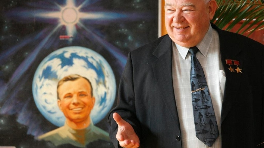 FILE - In this Tuesday, Sept. 25, 2007 file photo, cosmonaut Georgy Grechko stands in front of a painting showing Yuri Gagarin, the first human in space, at the Russian cosmonauts living quarters in northern Moscow, Russia. Russian space agency Roscosmos said on Saturday, April 8, 2017 Soviet-era cosmonaut Georgy Grechko has died at age 85. Grechko made three trips into space between 1975 and 1985, spending a total of 134 days off the Earth. His longest was a stay of more than three months aboard the Salyut-6 space station in 1977-78. (AP Photo/Mikhail Metzel, file)