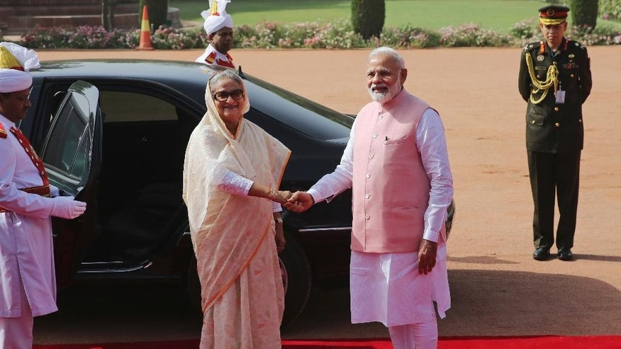Indian Prime Minister Narendra Modi shakes hand with his Bangladeshi counterpart Sheikh Hasina at the Presidential Palace in New Delhi, India, Saturday, April 8, 2017. India and Bangladesh have signed a slew of agreements, including a $4.5 billion concessionary line of credit from India for development projects in Bangladesh, as the South Asian neighbors try to deepen their ties. (AP Photo)