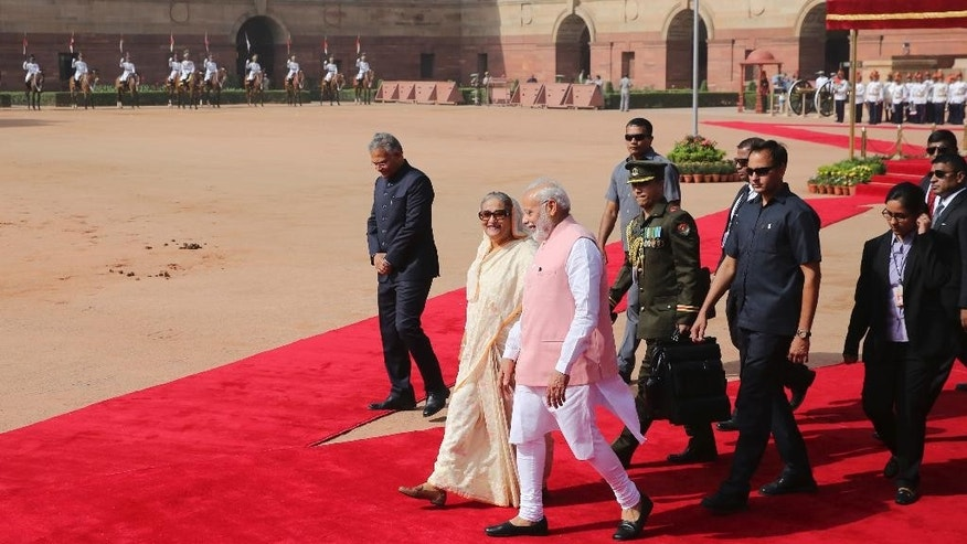 Indian Prime Minister Narendra Modi walks with his Bangladeshi counterpart Sheikh Hasina at the Presidential Palace in New Delhi, India, Saturday, April 8, 2017. India and Bangladesh have signed a slew of agreements, including a $4.5 billion concessionary line of credit from India for development projects in Bangladesh, as the South Asian neighbors try to deepen their ties. (AP Photo)