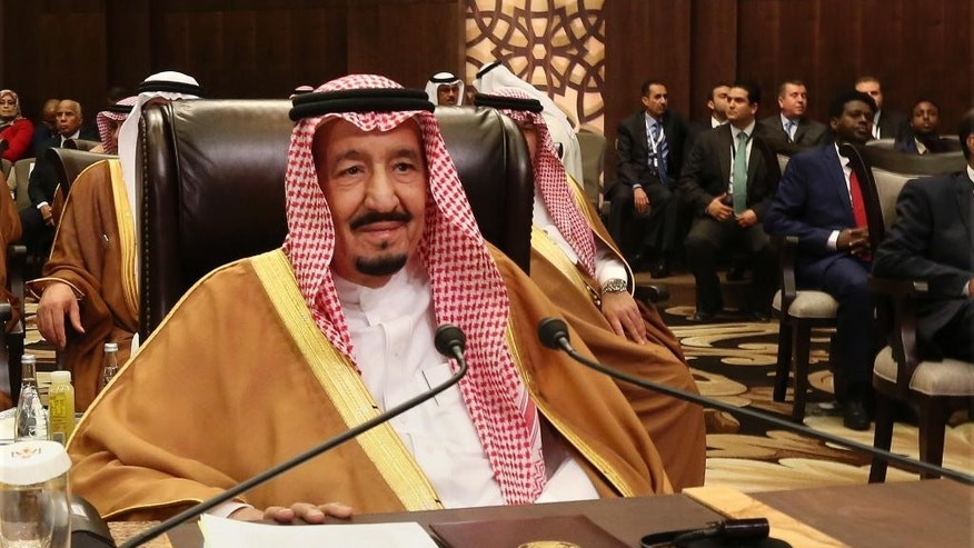 FILE - In this March 29, 2017 file photo, Saudi Arabia's King Salman attends the summit of the Arab League at the Dead Sea, Jordan. The official Saudi Press Agency is reporting on Saturday, April 8, 2017 that U.S. President Donald Trump has spoken by telephone with King Salman about the U.S. missile strike on Syria. (AP Photo/Raad Adayleh, File)