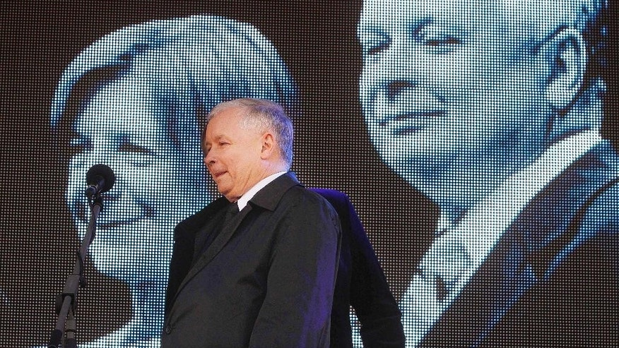 FILE - The April 10, 2016 file photo shows Law and Justice leader, the twin brother of former President of Poland Lech Kaczynski, Jaroslaw Kaczynski delivers a speech during a ceremony to mark the sixth anniversary of the crash of the Polish government plane in Smolensk, Russia, that killed 96 people on board including Kaczynski and his wife Maria. It's been seven years since Poland lost its president in a plane crash in Russia. His twin brother, who effectively runs the Polish government today, remains in mourning, only wearing black suits and black ties in public - and determined to punish those he blames for the crash. Jaroslaw Kaczynski has used his position as leader of Poland's ruling party to direct state bodies to try to debunk official findings that the crash was an accident. (AP Photo/Czarek Sokolowski, File)