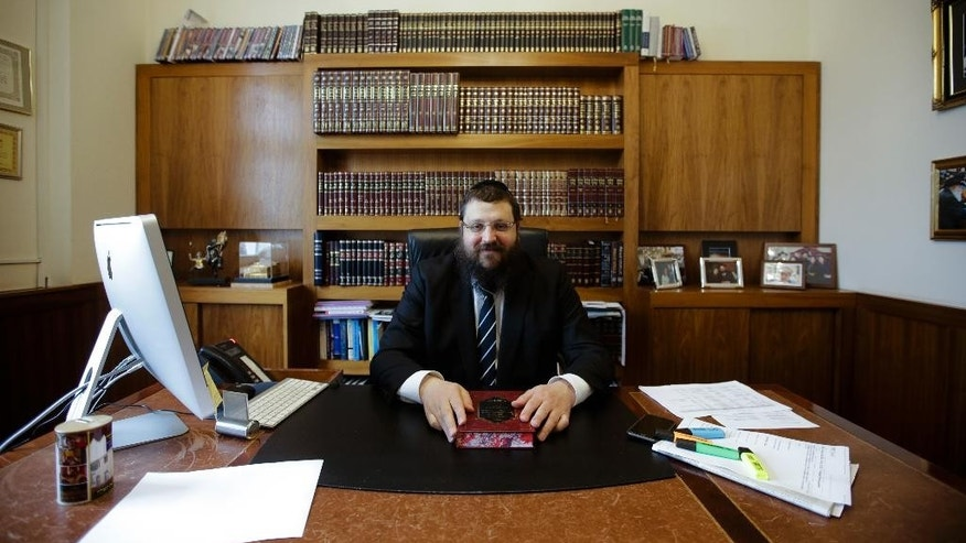 In this photo taken Monday April 3, 2017 Rabbi Yehuda Teichtal sits at his desk during an interview with the Associated Press about the plannings for a Jewish Campus in Berlin, Germany. (AP Photo/Markus Schreiber)
