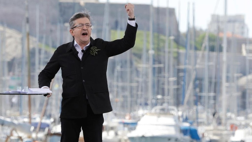 French hard-left presidential candidate, Jean-Luc Melenchon, speaks during a campaign rally in Marseille's Old Port, southern France, Sunday, April 9, 2017. The two-round presidential election is set for April 23 and May 7. (AP Photo/Claude Paris)