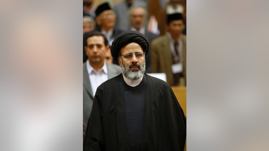 In this April 22, 2009 photo, Ebrahim Raisi attends a meeting of top prosecutors from Islamic countries, in Tehran, Iran. Iran's official IRNA news agency reported Sunday April 9, 2017, that Raisi, a hard-line cleric and close ally of Iran's supreme leader, has announced he will run in the May presidential election. (AP Photo/Vahid Salemi)