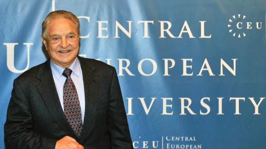 "FILE - In this Oct. 26, 2009 file photo Hungarian born US billionaire and investor George Soros is pictured ahead of the start of his five-day-long lecture at the Central European University, CEU, in Budapest, Hungary. Hungary's efforts to close Central European University, founded by Soros in 1991, are an extraordinary, risky step in Prime Minister Viktor Orban's plan to transform his country into an ""illiberal state."" (AP Photo/Bela Szandelszky, file)"