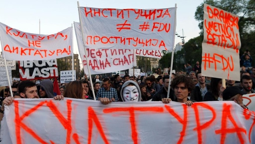 "Protesters march holding banners: ""Culture?"", down, ""Culture, no dictatorship!"", top left, ""Institution is not prostitution"", top center and ""Drama artists are walking!"", during a protest in Belgrade, Serbia, Sunday, April 9, 2017. Thousands of people have protested for the seventh consecutive day against the presidential election victory of Serbia's powerful Prime Minister Aleksandar Vucic, amid fresh allegations by the opposition of a rigged vote count. (AP Photo/Darko Vojinovic)"