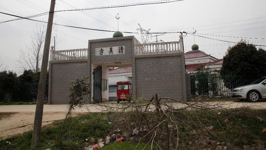 In this photo taken Friday, March 17, 2017, the Nangang mosque, is seen in Hefei in central China's Anhui province. On the dusty plains of the Chinese heartland, the bitter fight over the mosque illustrates how a surge in anti-Muslim sentiment online is spilling over into the real world. If left unchecked, scholars say, such attitudes risk inflaming simmering ethnic tensions that have in past erupted in bloodshed. (AP Photo/Gerry Shih)