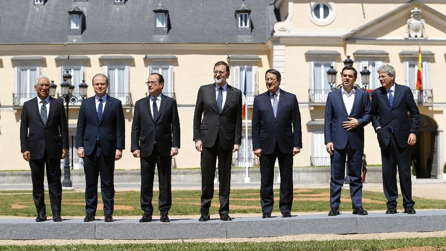 From left to right, Portuguese Prime Minister Antonio Costa, Malta's Prime Minister Joseph Muscat, France's President Francois Hollande, Spain's Prime Minister Mariano Rajoy, Cyprus' President Nicos Anastasiades, Greece's Prime Minister Alexis Tsipras and Italy's Prime Minister Paolo Gentiloni, pose for an official photo during the southern European Union countries summit at the El Pardo palace, outside Madrid, Spain, Monday, April 10, 2017. The leaders of France, Italy, Spain, Greece, Portugal, Malta and Cyprus are attending their third informal summit after they met in Athens and Lisbon. (AP Photo/Francisco Seco)