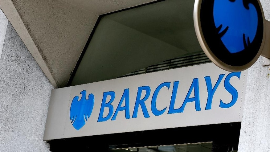 FILE - This July 29, 2015 file photo shows the sign on a branch of Barclays Bank in London. The CEO of Barclays bank, Jes Staley, is being investigated by regulators for his attempts to unmask a whistleblower, the bank said Monday April 10, 2017, who had written anonymous letters raising concerns about a senior employee,. (AP Photo/Kirsty Wigglesworth, File)