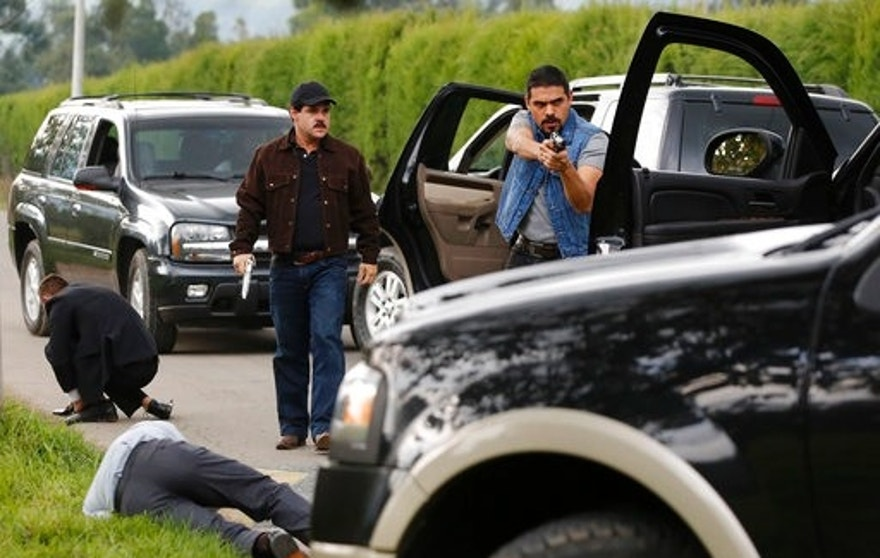 "In this March, 21, 2017 photo, Mexican actor Marco de la O, back left, plays drug lord Joaquin Guzman during the filming of ""El Chapo"" in Tabio, Colombia. At the time filming started, Guzman was still in Mexico and the series' location was shifted for security reasons, said producer Daniel Posada. ""Colombia was a good option, because we have well-trained crews and it is very similar in appearance to Mexico."" (AP Photo/Fernando Vergara)"