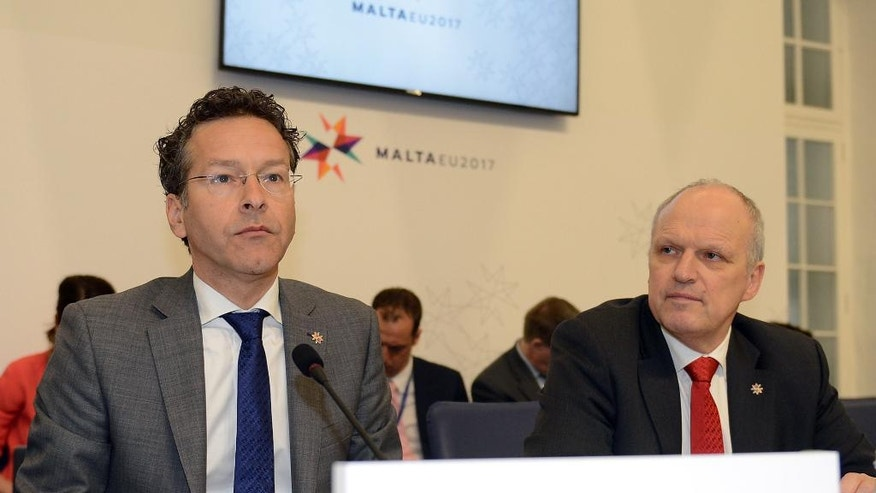 "Eurozone chairman Jeroen Dijsselbloem, left, and Director-General for Economic Affairs and Competitiveness Carsten Pillath attend a meeting of European finance ministers, in Valletta, Malta, Friday, April 7, 2017. The chief of the eurozone said Friday that he was ""in a positive mood"" about a breakthrough in Greece's difficult bailout talks, but stressed an overall political deal could not be reached at Friday's meeting of finance ministers using the shared currency. (AP Photo/Rene Rossignaud)"
