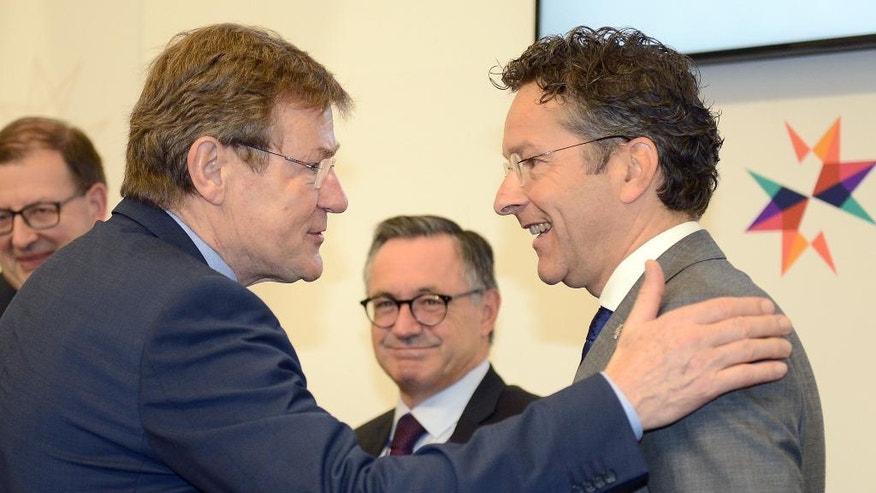 "Belgian Finance Minister Johan VanOvertveldt, left, and Eurozone chairman Jeroen Dijsselbloem greet eachother ahead of a meeting of European finance ministers, in Valletta, Malta, Friday, April 7, 2017. Dijsselbloem said Friday that he was ""in a positive mood"" about a breakthrough in Greece's difficult bailout talks, but stressed an overall political deal could not be reached at Friday's meeting of finance ministers using the shared currency. (AP Photo/Rene Rossignaud)"