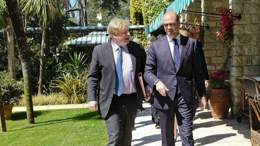 Italian Foreign Minister Angelino Alfano, right, and British Secretary of State Boris Johnson arrive for a bilateral meeting in Forte dei Marmi, near Lucca, Monday, April 10, 2017. Alfano and Johnson will attend a G7 Foreign ministers meeting in Lucca on Monday and Tuesday. (Riccardo Dalle Luche/ANSA via AP)