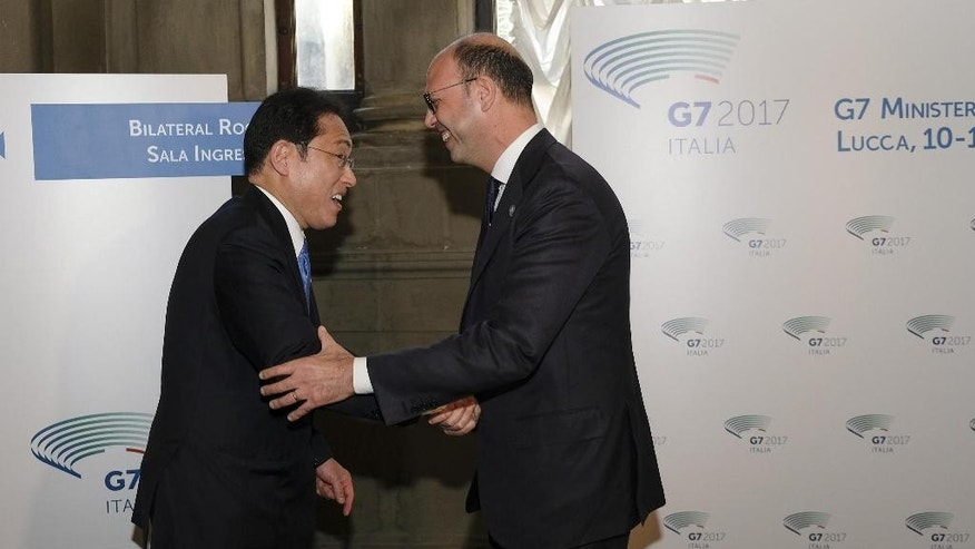 Italian Minister of Foreign Affairs Angelino Alfano, right, meets his Japan's counterpart Fumio Kishida during a bilateral meeting in Lucca, Italy, Monday, April 10, 2017. (Riccardo Dalle Luche/ANSA via AP)