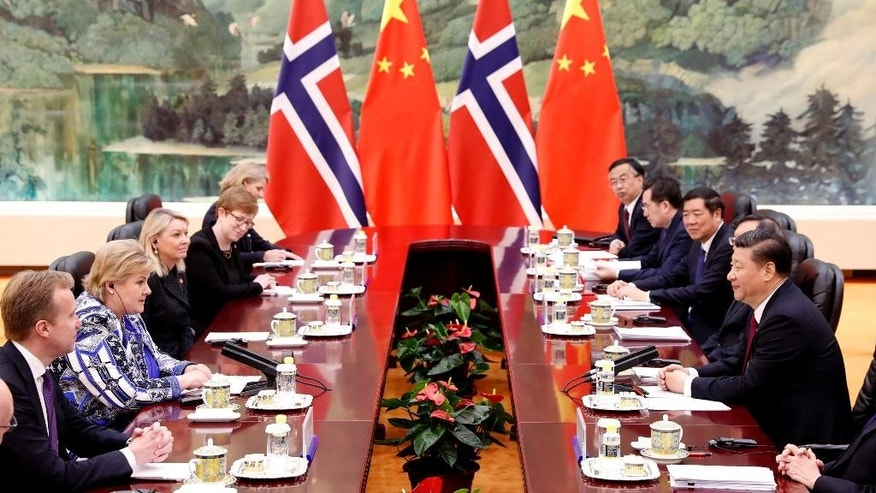 Chinese President Xi Jinping, right, holds a talk with Norwegian Prime Minister Erna Solberg, second from left,  at the Great Hall of People in Beijing, China on Monday April 10, 2017. (Yohei Kanasashi/Pool Photo via AP)