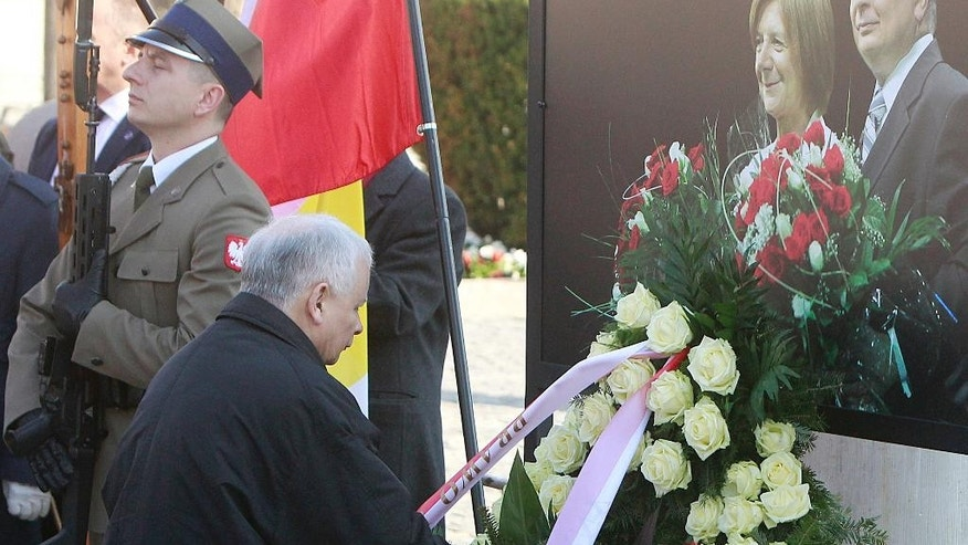 Jaroslaw Kaczynski, the head of the ruling Law and Justice party, lays a wreath in memory of his brother, President Lech Kaczynski, on the seventh anniversary of this brother's death, in Warsaw , Poland, Monday, April 10, 2017. Poland on Monday remembers the president and 95 others who died with him in a plane crash in Russia on April 10, 2010. (AP Photo/Czarek Sokolowski)