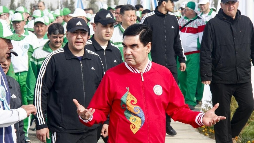 In this Friday, April 7, 2017 photo Turkmen President Gurbanguli Berdymukhamedov attends the opening ceremony of a new sports complex at the new tourist zone of Awaza on the Caspian Sea in Turkmenistan. Turkmenistan is hosting the fifth Asian Indoor and Martial Arts Games this year. (AP Photo/Alexander Vershinin)
