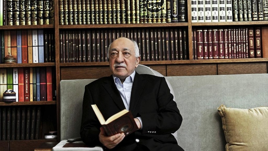 FILE – In this March 15, 2014 file photo, Turkish Muslim cleric Fethullah Gulen, sits at his residence in Saylorsburg, Pennsylvania, United States. Followers of the Gulen movement in Germany have received several death threats since the aborted military coup in Turkey.  (AP Photo/Selahattin Sevi, File)