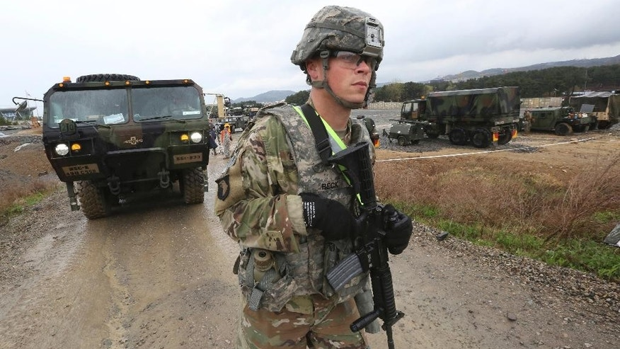 A U.S. Marine soldier conducts the U.S.-South Korea joint Exercise Operation Pacific Reach in Pohang, South Korea, Tuesday, April 11, 2017. North Korea is vowing tough counteraction to any military moves that might follow the U.S. move to send the USS Carl Vinson aircraft carrier and its battle group to waters off the Korean Peninsula. (AP Photo/Ahn Young-joon)