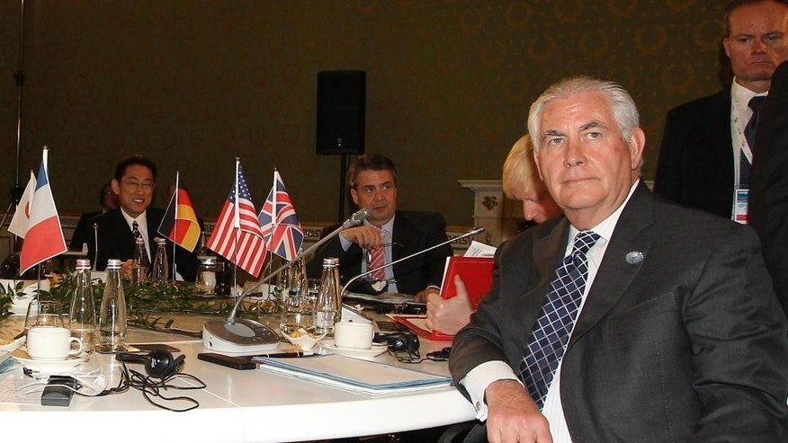 US Secretary of State Rex Tillerson sits at the table during a meeting of foreign ministers of the G7 in Lucca, Italy, Tuesday, April 11, 2017. Foreign ministers from the Group of Seven industrialized nations are expected to call for a new international push to end the war in Syria as they end a meeting in Italy Tuesday.  (Riccardo Dalle Luche/ANSA via AP)