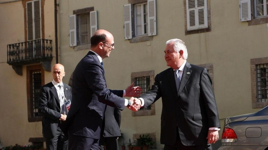 Italian Foreign Minister Angelino Alfano, left, welcomes US Secretary of State Rex Tillerson, before the meeting of foreign ministers of the G7 in Lucca, Italy, Tuesday, April 11, 2017. Foreign ministers from the Group of Seven industrialized nations are expected to call for a new international push to end the war in Syria as they end a meeting in Italy Tuesday.  (Riccardo Dalle Luche/ANSA via AP)