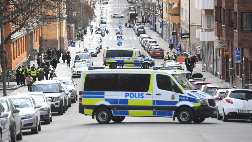 Police vans block the street outside Stockholm District Court as 39-year-old Uzbekistan national Rakhmat Akilov, prime suspect in Friday's truck attack, appears at a remand hearing in the court, Tuesday April 11, 2017. The four people killed in the attack included two Swedes, a British man and a Belgian woman. (Fredrik Sandberg/TT via AP)