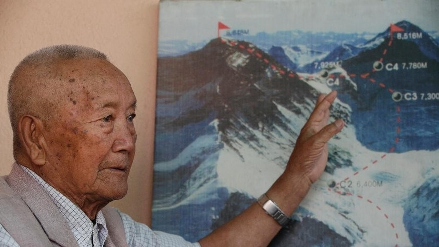 April 11, 2017: Nepalese climber Min Bahadur Sherchan, points to a picture to describe the trail to Mount Everest, as he talks to Associated Press at his residence in Kathmandu, Nepal.