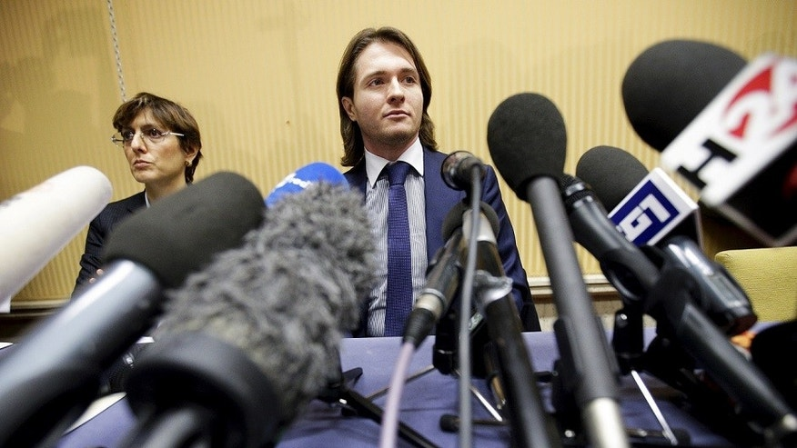 Raffaele Sollecito with his lawyer Giulia Bongiorno during a news conference in 2015.