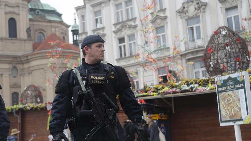 A policeman patrols the Old Town Square downtown Prague, Czech Republic, Wednesday, April 12, 2017. Czech authorities are boosting security measures across the country over Easter and Passover holidays following recent terror attacks in Europe. (AP Photo/Petr David Josek)