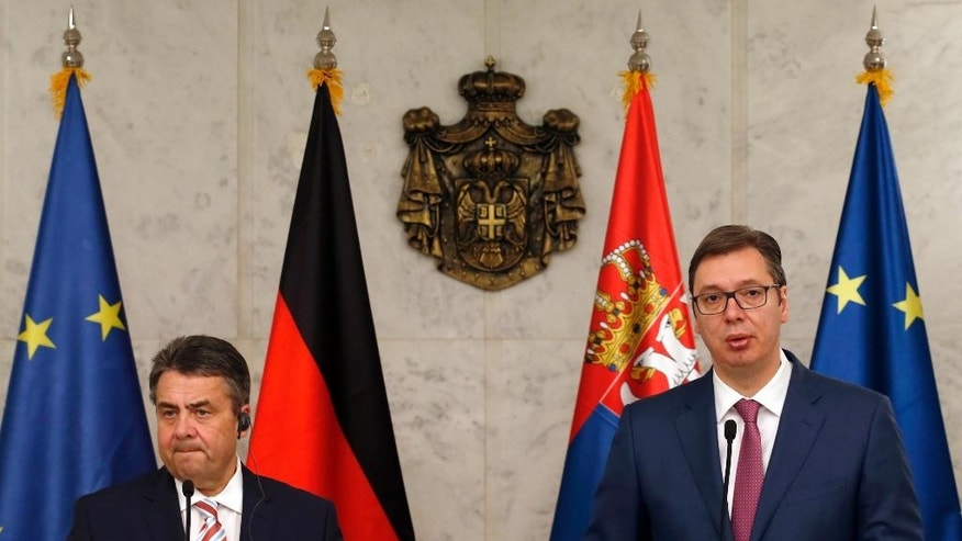 German Foreign Minister Sigmar Gabriel, left, and Serbian Prime Minister Aleksandar Vucic attends a news conference, in Belgrade, Serbia, Wednesday, April 12, 2017. Gabriel is on a two-day official visit in Serbia. (AP Photo/Darko Vojinovic)