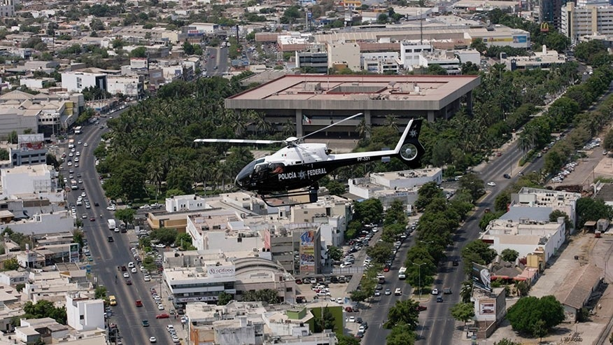 A police helicopter flies over Culiacan May 28, 2008.