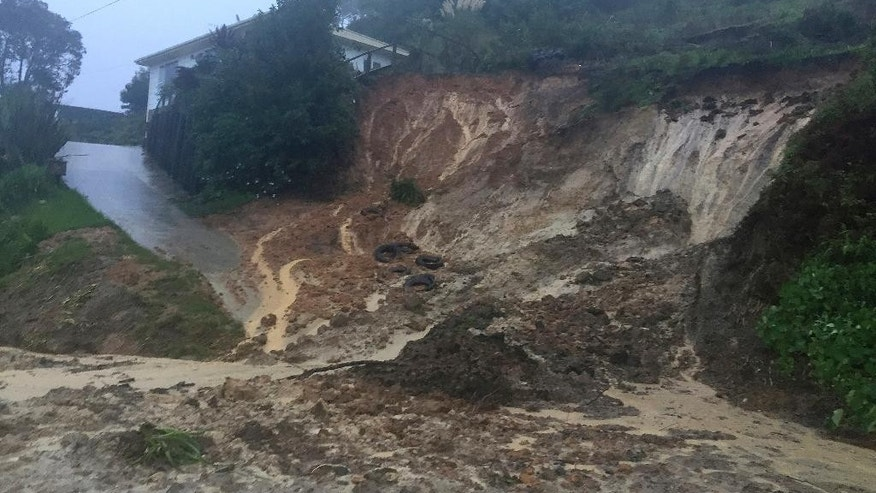 A landslide blocks a road in the North Island town of Omokoroa, New Zealand. Thursday, April 13, 2017. Hundreds of people in New Zealand were evacuated from some coastal areas on Thursday as the second major storm in just over a week made landfall near the North Island town of Whakatane. (Jamie Morton/New Zealand Herald via AP)