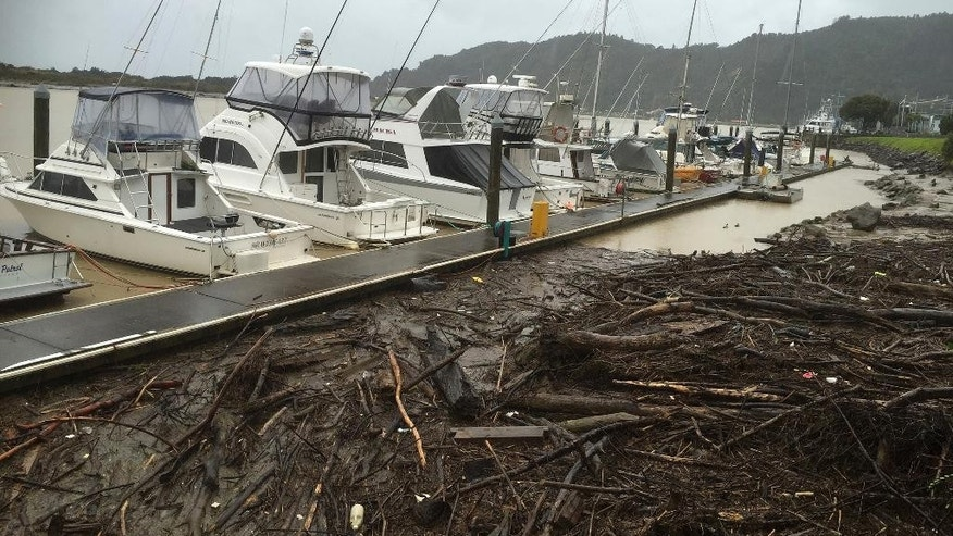 Logs and debris from a week of flooding are collected behind boats moored on the Whakatane River, New Zealand, Thursday, April 13, 2017. Hundreds of people in New Zealand were evacuated from some coastal areas on Thursday as the second major storm in just over a week made landfall near the North Island town. (JAlan Gibson/New Zealand Herald via AP)