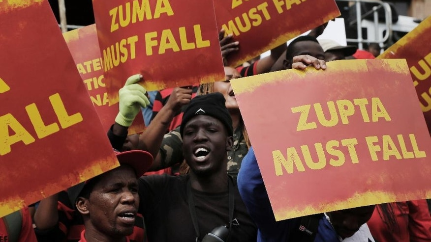 Members of the Economic Freedom Fighters prepare to march in protest to the Government Union Buildings in Pretoria, South Africa Wednesday, April 12, 2017. South Africa's opposition groups marked the 75th birthday of President Jacob Zuma with a protest against him, pushing for his resignation because of scandals and his dismissal of a widely respected finance minister. (AP Photo/Denis Farrell)