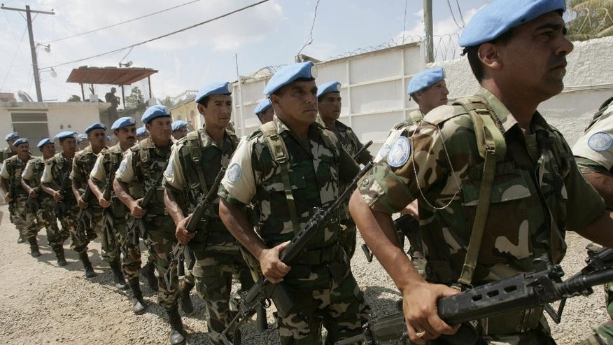 U.N. troops from Uruguay march at a base in Haiti.