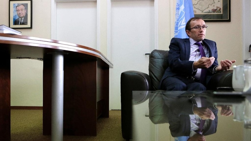 "U.N envoy Espen Barth Eide talks during an interview for the Associated Press at his office inside the U.N buffer zone at the abandoned Nicosia airport in the divided capital Nicosia, Cyprus, Thursday, April 13, 2017. A United Nations envoy says an ""idea"" has emerged that may help overcome the key obstacle of security which stands in the way of a deal reunifying ethnically divided Cyprus.  (AP Photo/Petros Karadjias)"