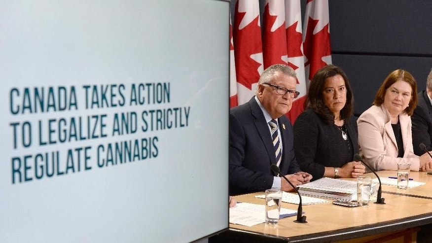 Minister of Public Safety and Emergency Preparedness Ralph Goodale, left to right, Justice Minister and Attorney General of Canada Jody Wilson-Raybould, and Health Minister Jane Philpott announce changes regarding the legalization of marijuana during a news conference in Ottawa, Thursday, April 13, 2017. (Adrian Wyld/The Canadian Press via AP)