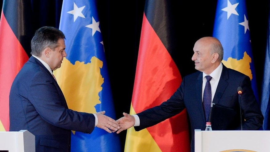 Kosovo's Prime Minister Isa Mustafa, right, shakes hands with German Foreign Minister Sigmar Gabriel during his visit to Kosovo in capital Pristina, on Thursday, April 13, 2017. Gabriel urged Pristina to improve relations with neighboring Serbia as it seeks entry into the European Union. (AP Photo/Visar Kryeziu)
