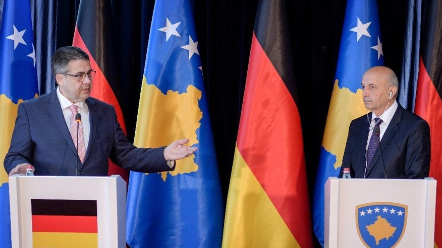 German Foreign Minister Sigmar Gabriel, left, gestures next to Kosovo's Prime Minister Isa Mustafa during a press conference in Kosovo's capital Pristina, on Thursday, April 13, 2017. Gabriel urged Pristina to improve relations with neighboring Serbia as it seeks entry into the European Union. (AP Photo/Visar Kryeziu)