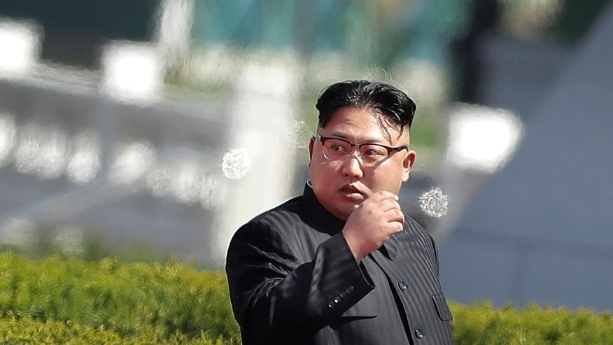 North Korean leader Kim Jong Un arrives for the official opening of the Ryomyong residential area, on Thursday, April 13, 2017, in Pyongyang, North Korea. Japan's Prime Minister Shinzo Abe, speaking Thursday at a parliamentary panel on national security and diplomacy, warned that North Korea may be capable of firing a missile loaded with sarin nerve gas toward Japan. (AP Photo/Wong Maye-E)